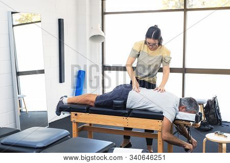 Man Having Chiropractic Back Adjustment. Physioterapy, Osteopathy, Alternative Medicine Pain Relief