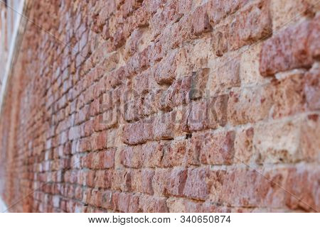 Closeup View Of Worn Red Brick Walls In Venice