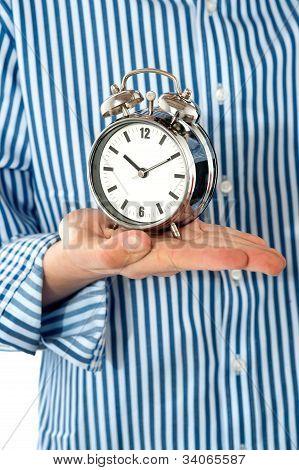 Boys Palm Holding Alarm Clock