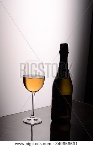 Still Life Of Wine Bottle Glass Studio Shooting
