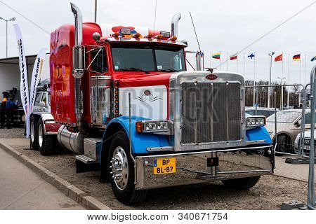 Riga, Latvia - April 12, 2019: Huge Red Peterbilt Truck Parked By The Road  - Image