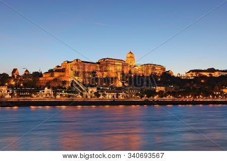 Scenic Evening Landscape View Of The Buda Side. Beautiful Illumination Of The Buda Castle (royal Pal