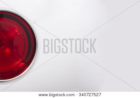 Glass Of Red Wine With Shadow With Text Field..top View