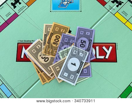 Orlando, Fl/usa-12/20/19:  Money For The Game Monopoly By Hasbro On A White Background.  Concept Bus