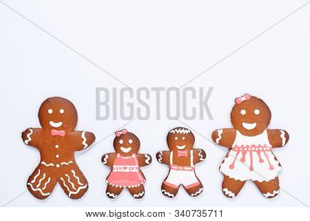 The Hand-made Eatable Gingerbread Family On White Background