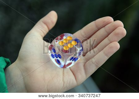 Kid Holding Dice In His Hand. Dice In Kids Hand.