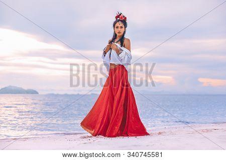 Beautiful Young Stylish Boho Woman Walking On The Beach At Sunset