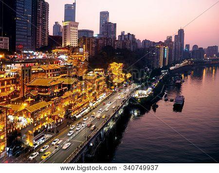 Chongqing, China - December 07, 2019 ; Night Landscape Of Hongyadong Shopping Complex Near The River