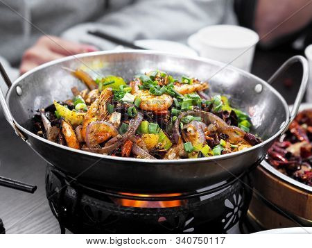 Close Up Chinese Spicy Food Sichuan Style. Stir Fried Seafood And Dried Chilies With Sichuan Pepper