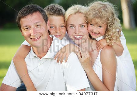 Family in summer park. Mother, father and children outdoors
