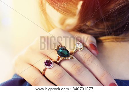 Close Up Of An Elegant Ring With Stones On Womans Hands. Concept Of Wealth, Jewelry. Many Rings On T