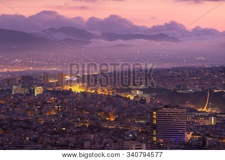 View Of Foggy North Athens From Lycabettus Hill At Sunrise, Greece.