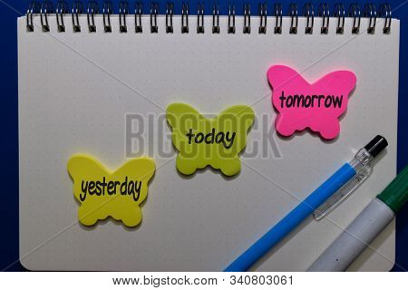 Yesterday, Today, Tomorrow Write On Sticky Notes Isolated On Office Desk