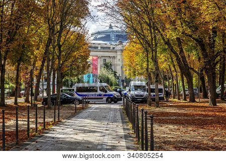 Paris, France, 09.10.2019: Autumn Street On The Champs Elysees. Cloudy Rainy Day.