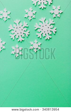 Christmas Background For Text Or Design. Wooden Snowflakes On A Mint Background. Popular Color Bisca