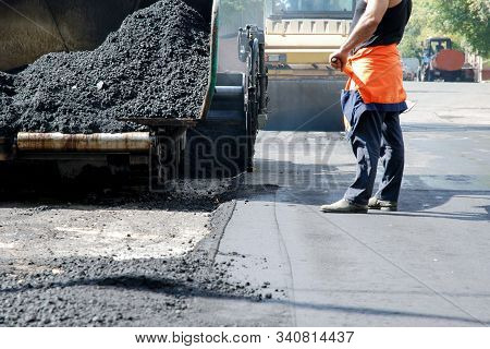 Asphalt Recycling Machine, Worker And Steam Roller At Roadworks Renewing City Street