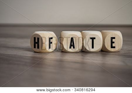 Cubes And Dice With The Opposite Of Hate And Fate On Wooden Background