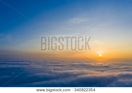 Yellow And Blue Dawn Over Clouds, Concept, Travel And Leisure.