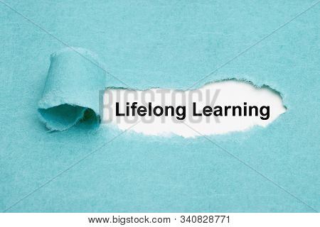 Printed Text Lifelong Learning Appearing Behind Ripped Blue Paper. Self-initiated Education And Pers