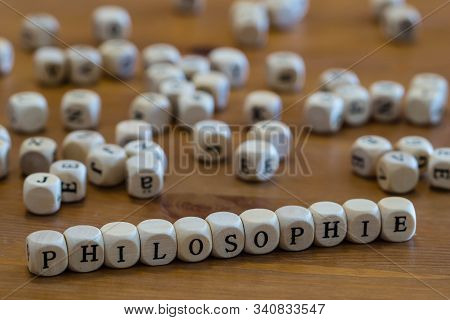 Philosophie In German Written With Wooden Cubes Letter
