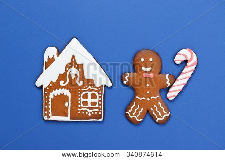 The Hand-made Eatable Gingerbread House, Little Men With Caramel On Blue Background