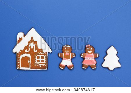 The Hand-made Eatable Gingerbread House, Little Men On Blue Background