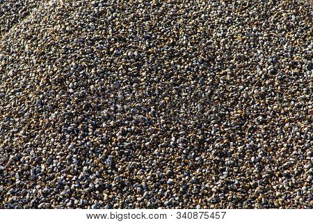 Rubble, A Pile Of Rubble In A Cement Plant. The Texture Of The Gravel. Background
