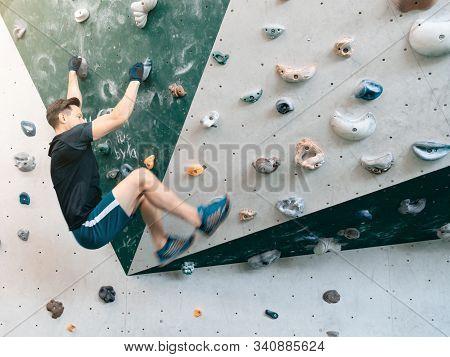 Man Climbing Bouldering Problem. Rock-climbing Icon. Man Climbing In Motion. Climbing Background.