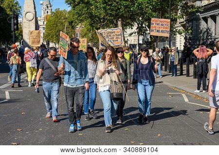 LONDON - SEPTEMBER 20, 2019: Climate Change protesters holding homemade protest signs in front of The Cenotaph, London at an Extinction Rebellion march
