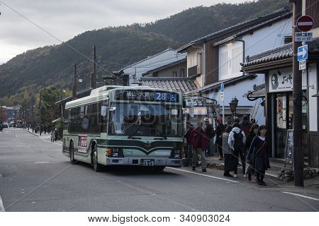 Kyoto, Japan-26 Nov, 2019: Kyoto City Bus Pass Through Arashiyama Street. The Kyoto City Buses Are M