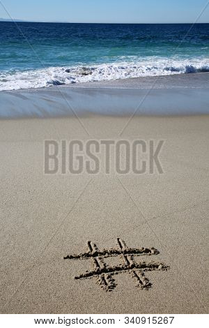 Pound Sign. Words written in sand on the beach. The Symbol Pound Sign # written in the sand of Laguna Beach California with the pacific ocean background. Hash Tag written in sand on the beach.