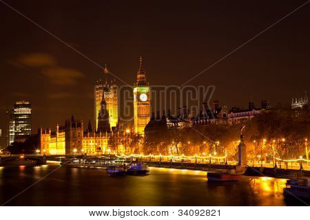 Landscape of Big Ben along river Thames from Hungerford Bridge at night London England UK