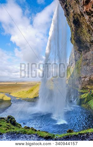 Seljalandsfoss Waterfall On A Sunny Day In Iceland