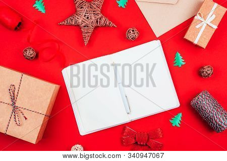 Top View Of Blank Notebook, Pen, Craft Gift Boxes, Envelope, Red Bow, Clew Of Tricolor Rope, Ribbon