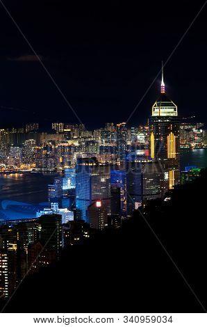 Wanchai, Hong Kong - May 31, 2013 - Central Plaza Skyscraper Illuminated At Night, As Seen From Stub