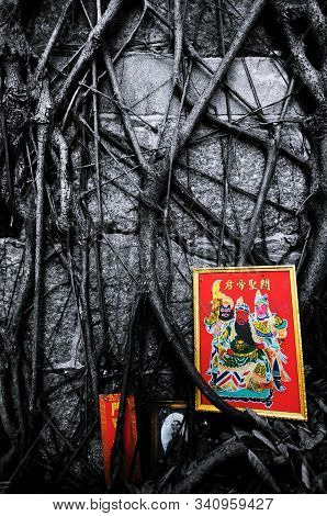 Guan Gong Portrait And Banyan Tree Roots