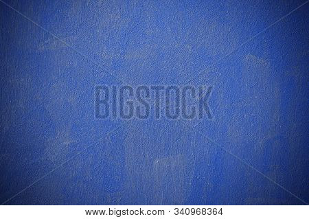 Blue Concrete Wall With A Textured Surface With Brush Marks. Modern Blue Trending Wall Color. Blue S