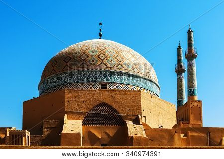 Old Mosque In Yazd City Against Blue Sky. Iran. Ancient Persia.