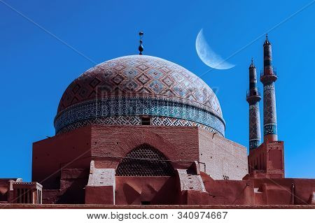 Old Mosque In Yazd City Against Night  Sky With Moon. Iran. Ancient Persia.