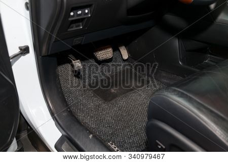 Dirty Car Floor Mats Of Gray Carpet With Gas Pedals And Brakes In The Workshop For The Detailing Veh
