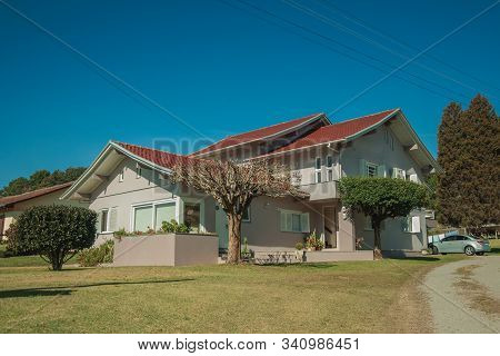 Modern Country House With Pathway And Garden In A Rural Landscape Near Bento Goncalves. A Friendly C