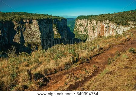 Dirt Pathway Aside The Itaimbezinho Canyon With Steep Rocky Cliffs Near Cambara Do Sul. A Small Coun