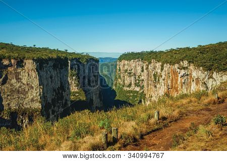 Dirt Pathway Aside The Itaimbezinho Canyon With Steep Rocky Cliffs Going Through A Flat Plateau Near