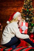 Lonely sad woman and christmas gift box. Nostalgic moments. Melancholy emotions. Merry christmas and happy new year. Dreamy mood. Present concept. Boxing day. New year is coming. Christmas eve poster