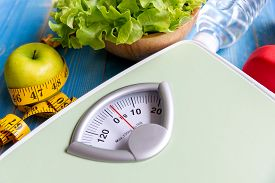 Diet And Healthy Life Loss Weight Concept. Green Apple And Weight Scale Measure Tap With Fresh Veget