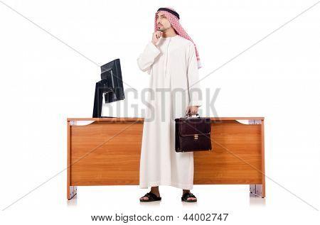 Arab man sitting at his desk