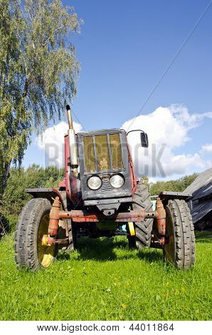 Ancient Tractor In Farm