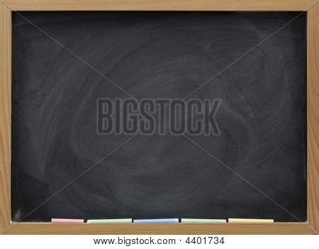 blank blackboard in wooden frame colorful chalk sticks and eraser smudges poster