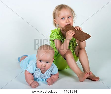 Young Girls Eating Bar Of Chocolate