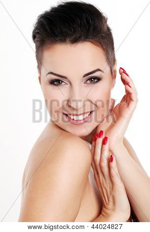 Young woman with short haircut in bathrobe isolated over white background